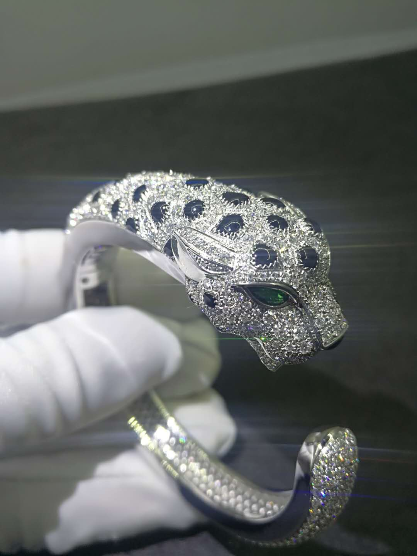 Panthère de Cartier bracelet 18K yellow gold set diamonds, onyx and Emeralds