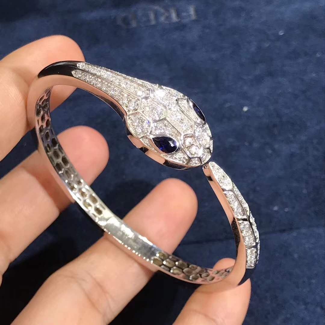 Bulgari/Bvlgari Serpenti bangle bracelet in 18kt white gold set with blue sapphire eyes and pavé diamonds BR858110