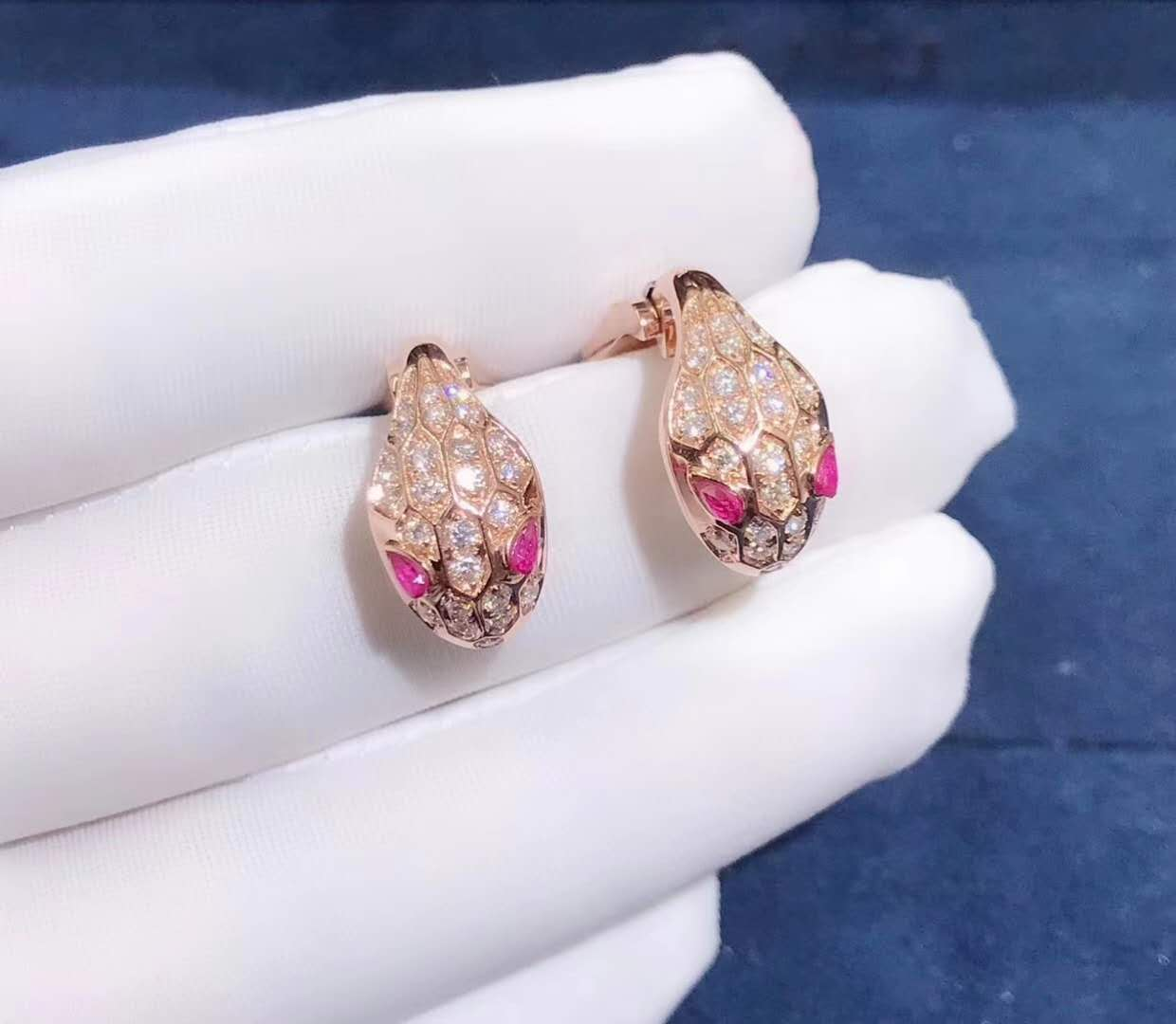 Bvlgari Serpenti Earrings in 18k rose gold set with rubellite eyes and full pave diamonds