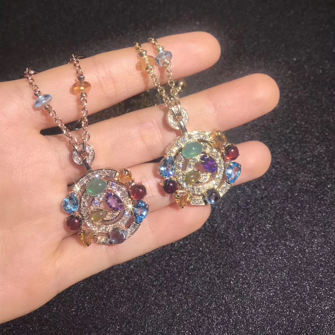 Bvlgari Astrale large pendant necklace in 18 kt yellow gold with gemstones
