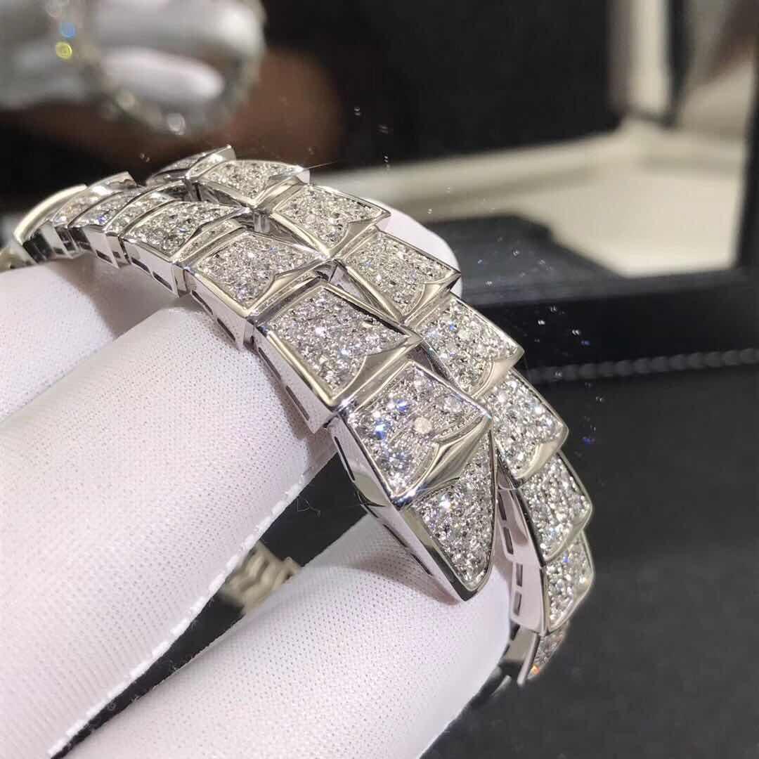 Bulgari/Bvlgari Serpenti one-coil bracelet in 18 kt white gold, set with full pavé diamonds.