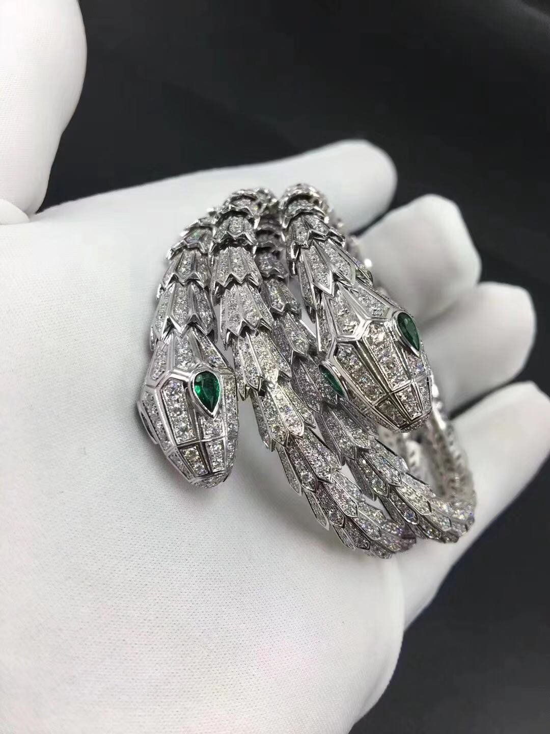 Bvlgari Serpenti 18kt white gold bracelet set with pavé diamonds and two emerald eyes